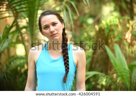 Woman with confused look on her face - stock photo
