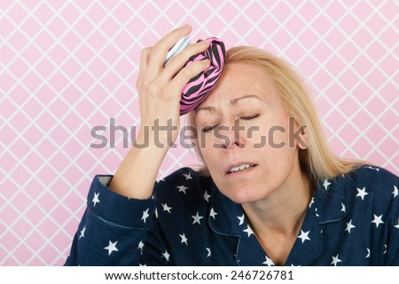 Woman with cool bag for headache - stock photo