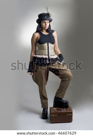 woman with corset breeches and hat