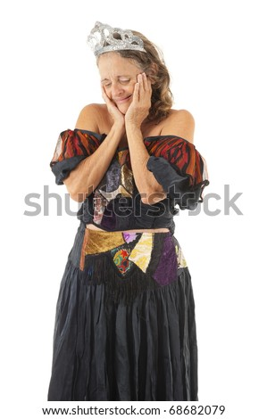 woman with costume crying on white background . - stock photo