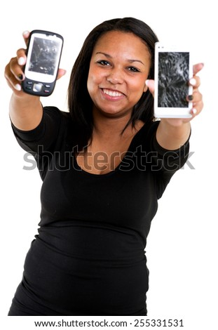 Woman with crashed cellphones - stock photo