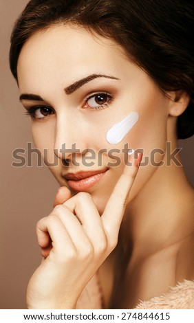 Woman with cream on her face - stock photo