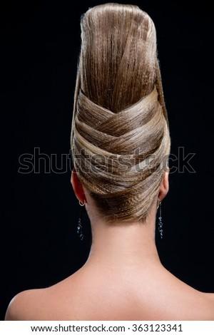 Woman with creative fashion hairstyle. Carmen. Spanish flamenco hairstyle - stock photo
