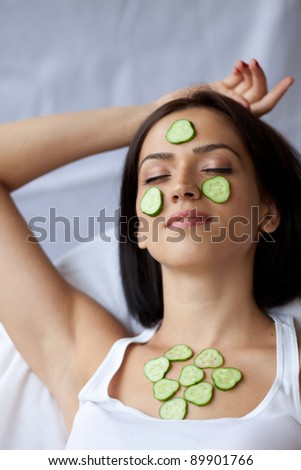 Woman with cucumbers - stock photo