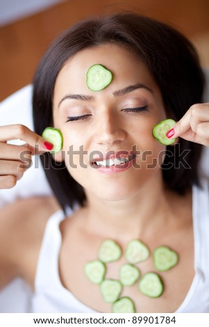 Woman with cucumbers