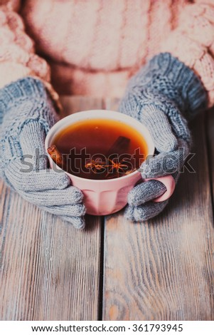 Woman with cup of tea - stock photo