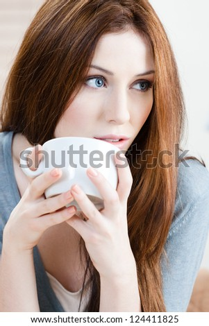 Woman with cup of tea has a rest at the coffee bar - stock photo