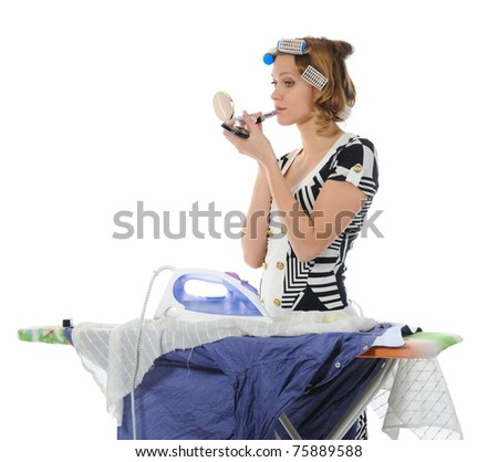 woman with curlers on her head stroking men shirt makes makeup.  Isolated on white background - stock photo