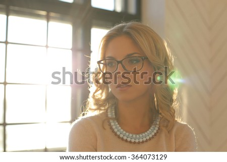 Woman with curly hair wearing a necklace - stock photo
