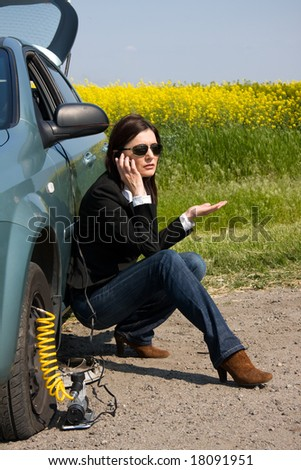 woman with damaged car calling for help - stock photo