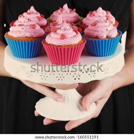 Woman with delicious cup cake, retro style - stock photo
