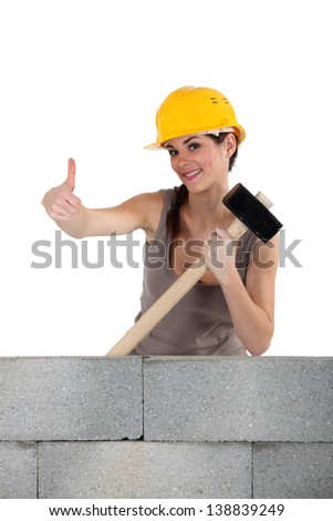 Woman with demolition hammer - stock photo