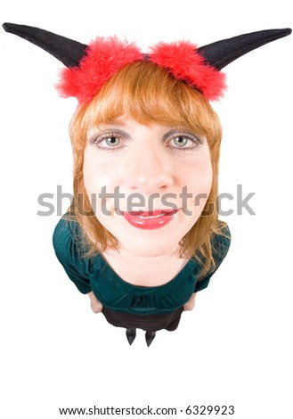 Woman with devil horns and red fleece is looking into the cam. Higher viewpoint, taken with a Fisheye. Isolated on white.