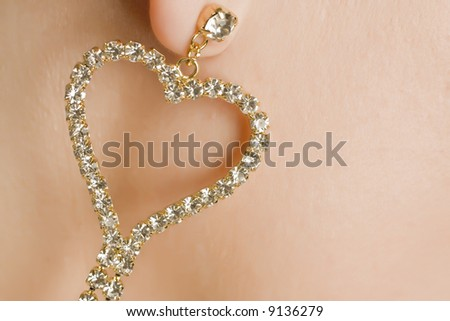 woman with diamond heart earing