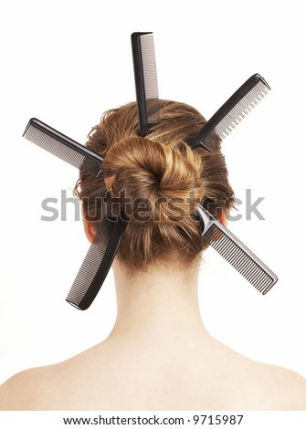 woman with different combs in her hair, hairdo concept - stock photo