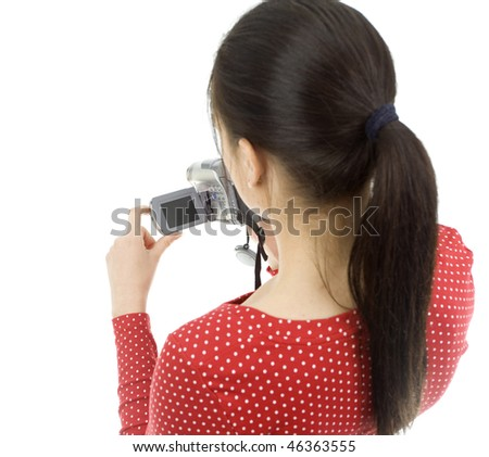 Woman with digital camera on the white background - stock photo