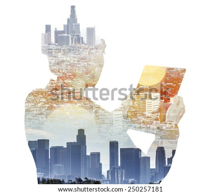 Woman with digital tablet composited with images of Los Angeles  - stock photo