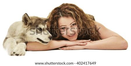 woman with dog Alaskan malamute  - stock photo