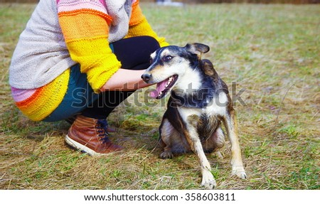 Woman with dog in spring meadows. Smiling Dog