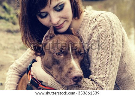 Woman with dog nature playing together  - stock photo
