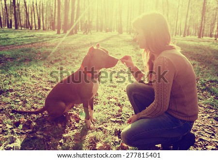 Woman with dog nature vintage - stock photo