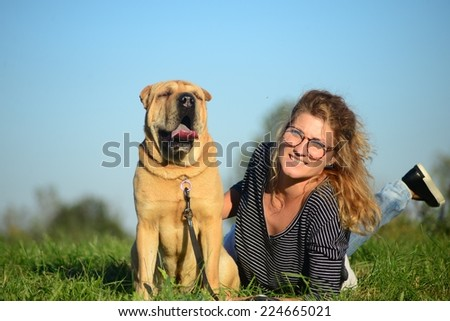 Woman with dog outdoors. - stock photo