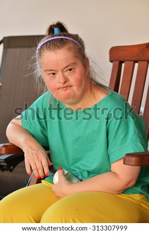 woman with down syndrome - stock photo