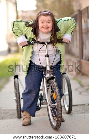 woman with down syndrome riding bike tricycle
