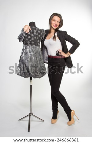 Woman with dressed mannequin - stock photo