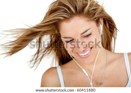 Woman with earphones listening to music - isolated over a white background - stock photo