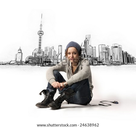 woman with earphones on the city background - stock photo