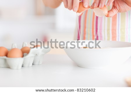 Woman with eggs and a bowl in an office - stock photo