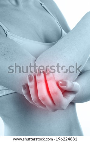 Woman with elbow pain isolated on white background - stock photo