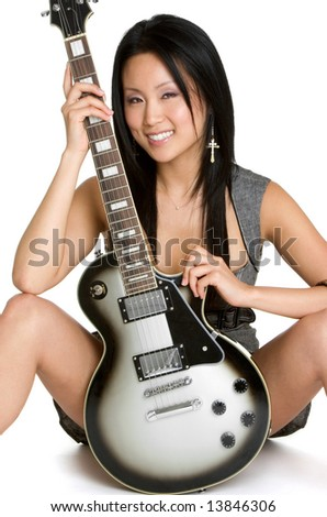 Woman with Electric Guitar - stock photo
