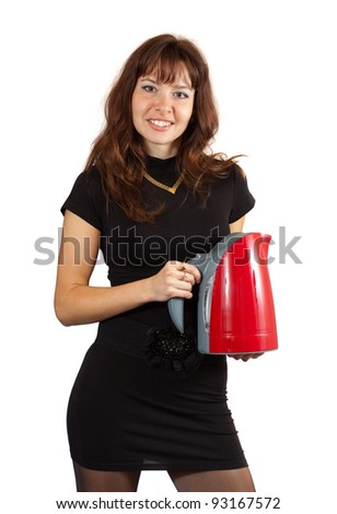 Woman with electric tea kettle. Isolated ove white background - stock photo
