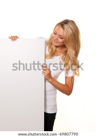Woman with empty poster to advertise the opening and offers - stock photo