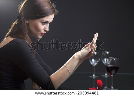 Woman with engagement ring in elegant restaurant