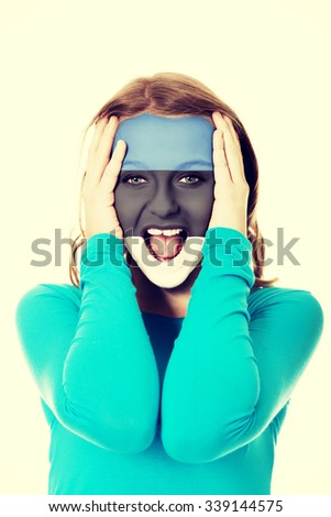 Woman with Estonia flag painted on face. - stock photo