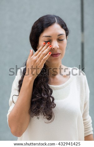 Woman with eye pain - stock photo