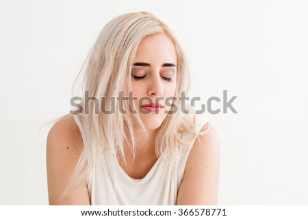 Woman with eyes closed. The concept of misunderstanding, of loneliness, frustration, failure, loss. photo on the white background - stock photo
