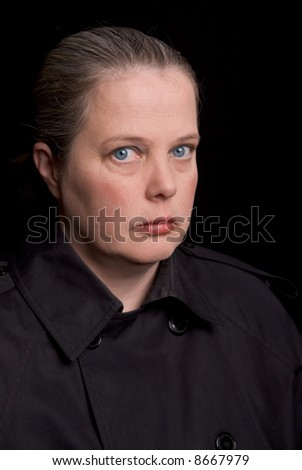 Woman with eyes open over a black background - stock photo