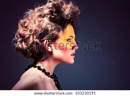 woman with face art and curly hair