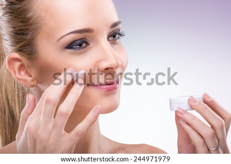 Woman with face cream - stock photo