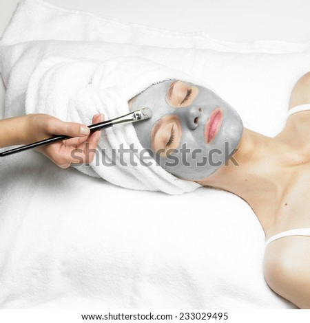 woman with facial mask - stock photo