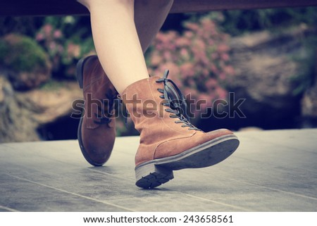 Woman with fashion leather boots - stock photo