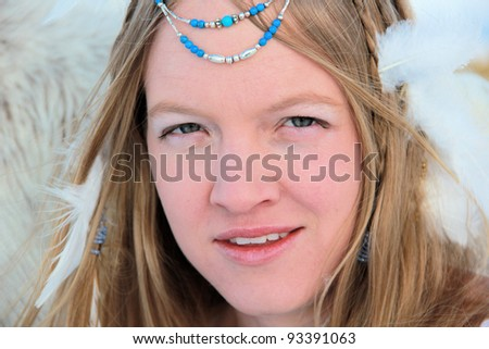 Woman with feathers in her hair - stock photo