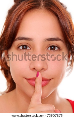 Woman with finger in his mouth as a sign of silence - stock photo
