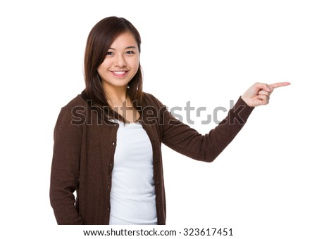 Woman with finger point aisde