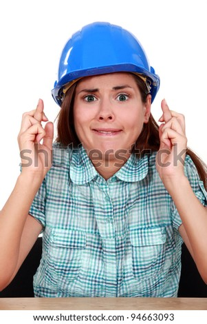 Woman with fingers crossed - stock photo