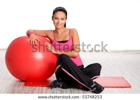 Woman with fitness ball - stock photo